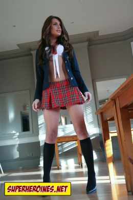 School girl in plaid skirt and crop top