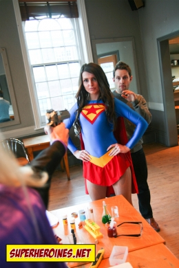 Supergirl protecting an innocent man