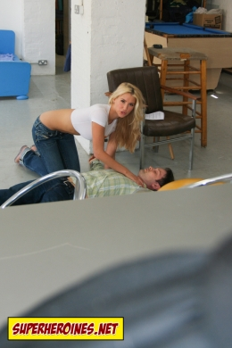 Danica Thrall bending over a man