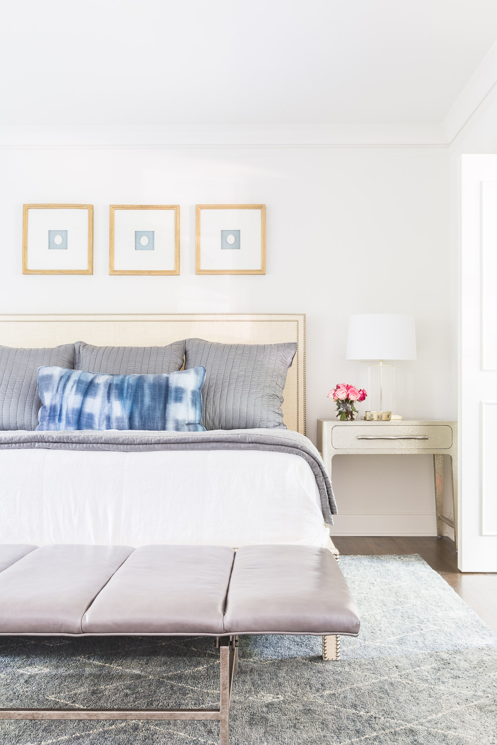 How to Decorate Above A Bed - Row of Frames