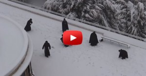 monks-playing-inthe-snow