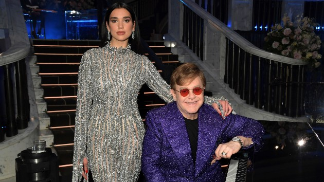 Elton John & Dua Lipa duet at annual Oscar party, raise $3 million for global effort to end AIDS