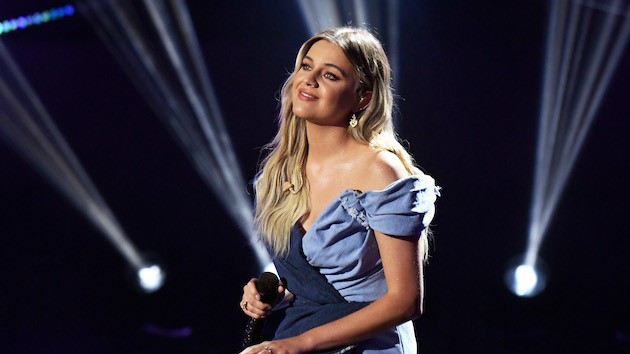 "Kelsea Ballerini ponders the road not taken in her ""half of my hometown"" music video"