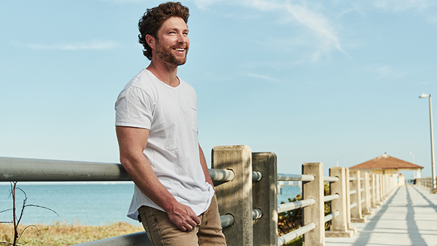 """Chris Lane used to work as a landscaper; still takes """"pride"""" in mowing his own lawn"""