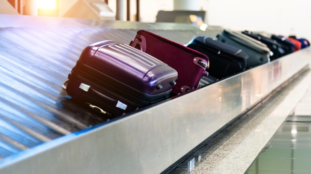 Two men charged in lost luggage scheme against US airlines