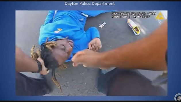 Body camera footage shows police officers dragging paralyzed man from a car by his hair