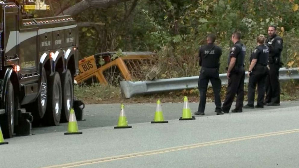 School bus carrying 6 children crashes into woods after driver suffers medical emergency