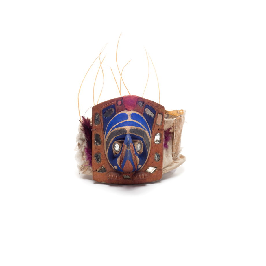 Yaxwiwe' or Raven frontlet, mirror pieces for eyes and around face, cloth and feather head band, sea lion whisker atop