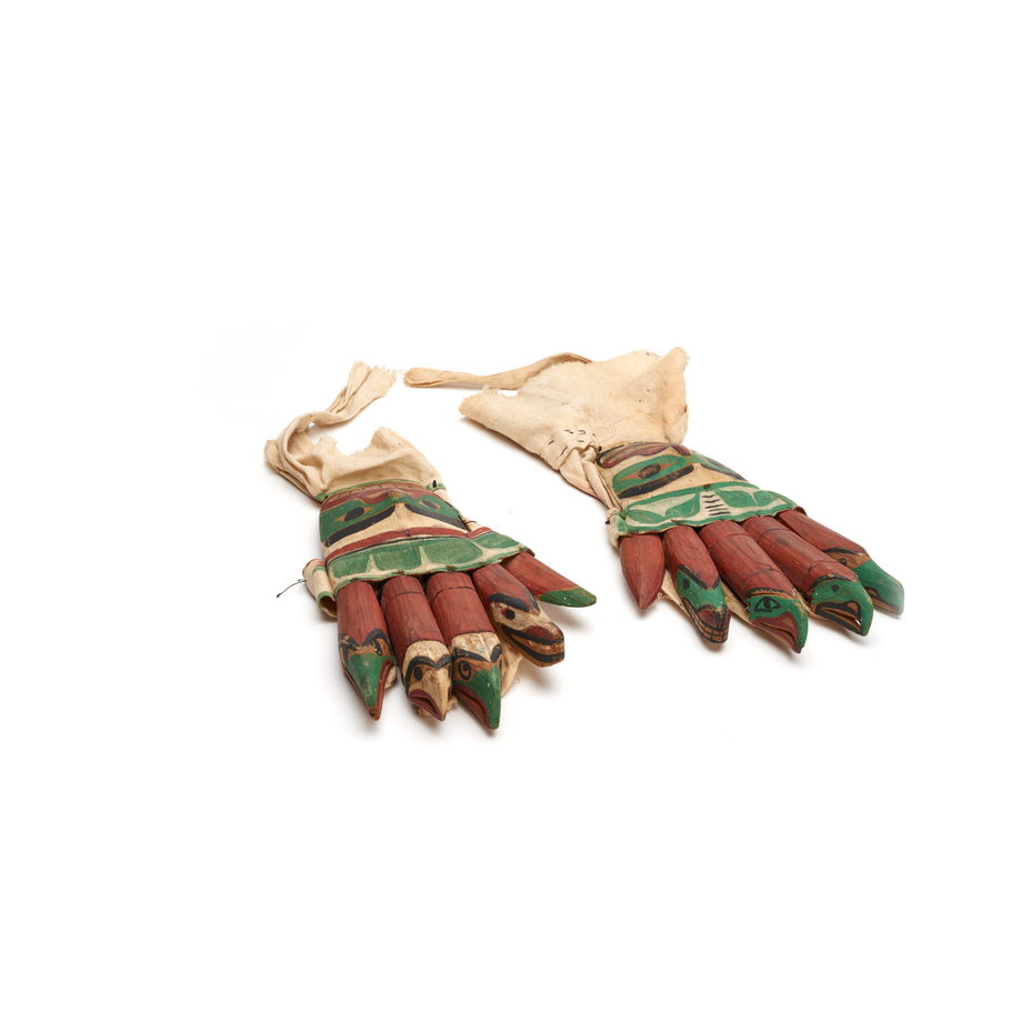 A pair of glove shaped rattles, each finger carved in animal shapes , part of a Bak´was or Wild Man of the Woods costume