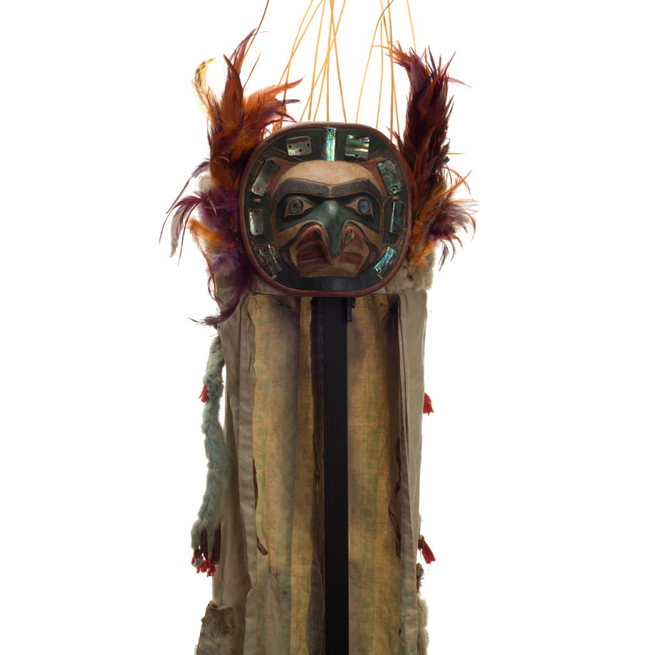 Yaxwiwe' or Hawk Headdress, abalone shell encircles hawk face on frontlet, feathers and sea lion whiskers above and at sides, long ermine and cotton train