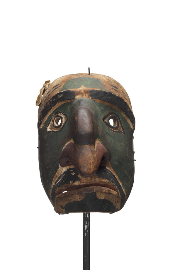 A Nułamał or fool dancer exaggerated nose with additional projection near bridge; large nostrils painted red; moustache and goatee painted black