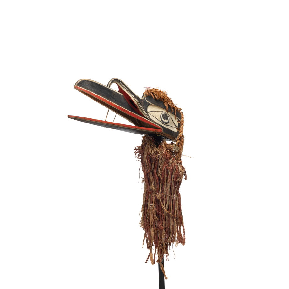 A mystical raven mask with long hinged beak, black, white and red painted markings with braided cedar back, top and below.