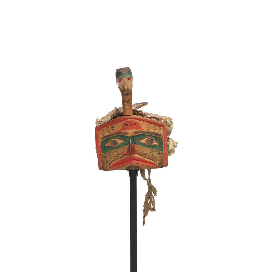 Łałkuxwiwe' or mallard headdress features a mallard head and neck projecting above the hawk face frontlet, carved wooden feathers and wing