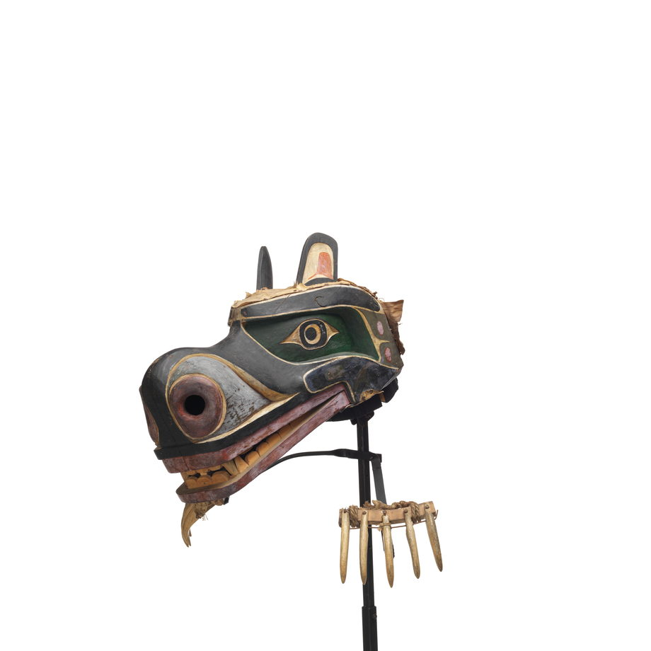Nan or grizzly bear mask with claws made of whale bone, attached to stand by wire supports, mask is painted black and green with red and white detailing