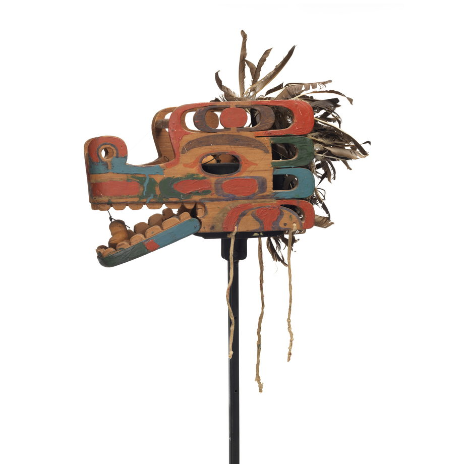 A Haietlik or serpent mask, elaborately carved with numerous cut-out parts, colourful markings in pale blue, green and red, feather trim, hinged lower jaw