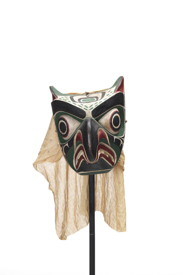 Daxdaxalułamł or Owl Mask, brightly coloured and patterned in black, red, green and white, cotton head covering