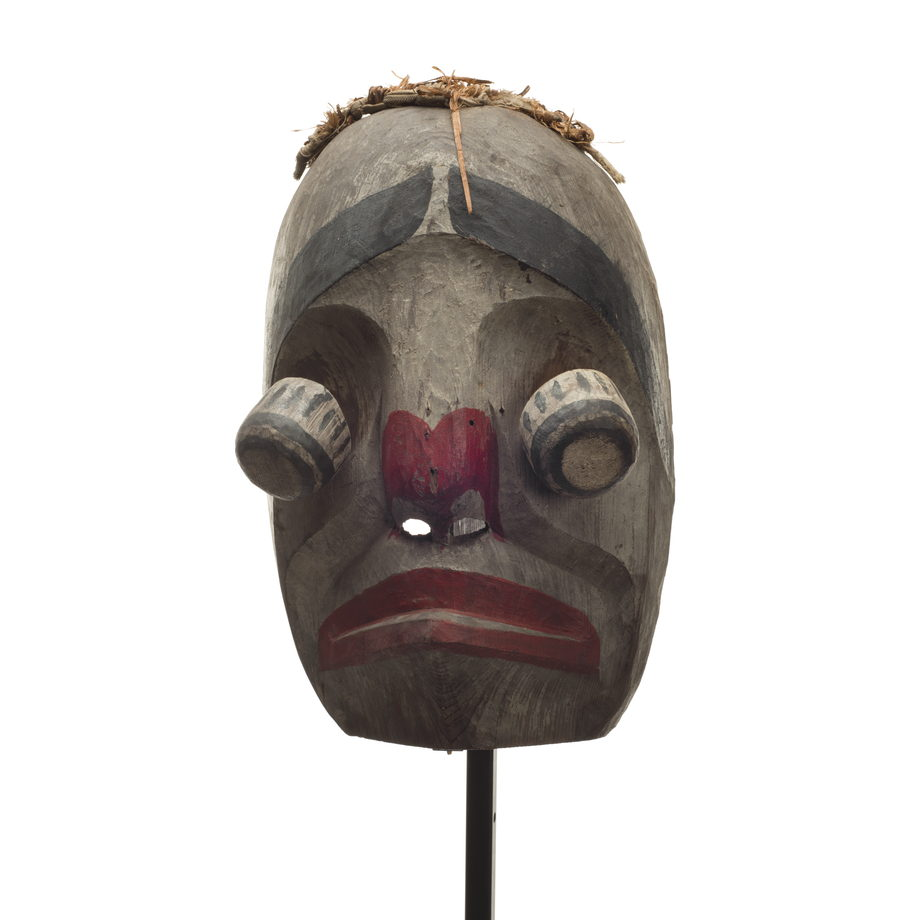 Atłak´ima or imitator mask, mostly white washed with bulging hinged eyes, red paint lips and around nostrils, thick black eyebrows and cedar bark trim