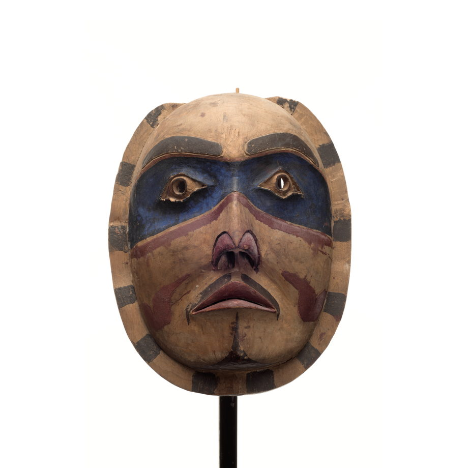 A 'Makwala or Moon Mask carved of cedar with blue patches around eyes and radial pattern around face