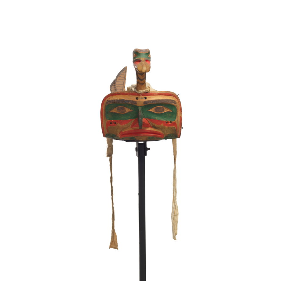 Łałkuxwiwe' or mallard headdress features a duck head and neck projecting above the hawk face frontlet, carved wooden feathers and wing