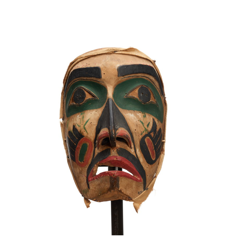 Hayakantalał, carved wood with holes for eyes and mouth, green patches around eyes, black markings with painted hand symbols on each cheek