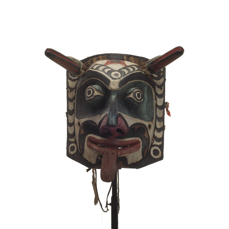 Xwixwi mask representing red snapper or cod angular corolla design decorated with black design elements incorporating circles and crescent shapes
