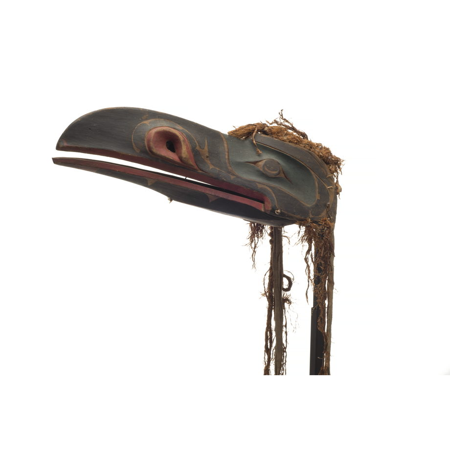 A raven headdress, dark appearance, hinged beak with green paint around eyes, red trim around beak and nostrils with thin and worn cedar trim