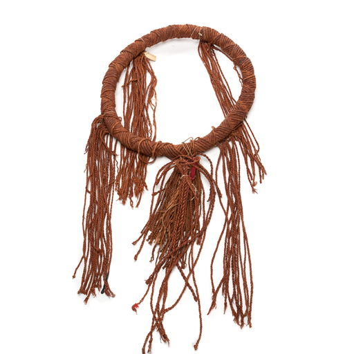 Tłagakwaxawa'yi or neck ring, woven and twisted circular band of red cedar bark with tassels attached in four bundles