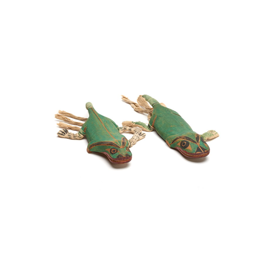 Two carved salamander figures, attached to forearms with string, painted bright green, part of a Bak´was or Wild Man of the Woods costume