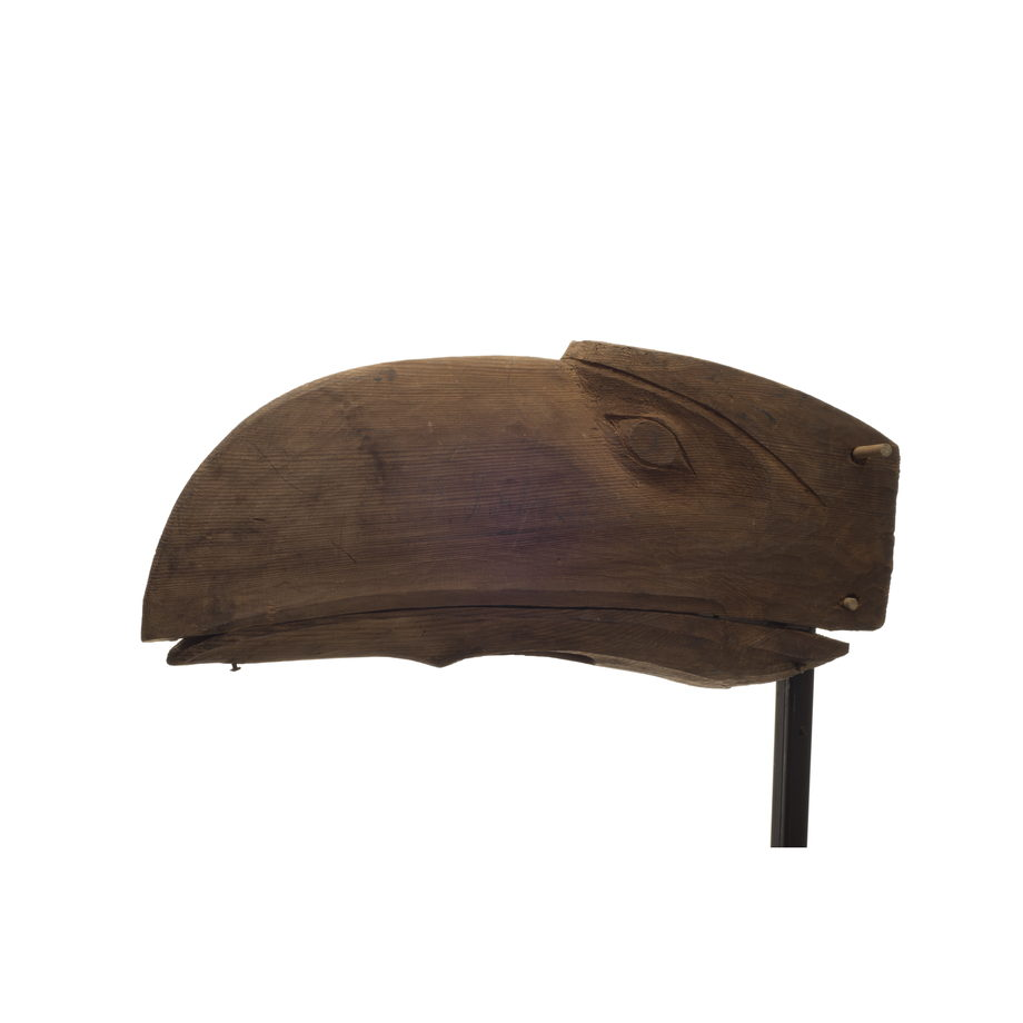 Gwa'wina or raven mask, lacks colouration, roughly carved and right eye unfinished, natural cedar