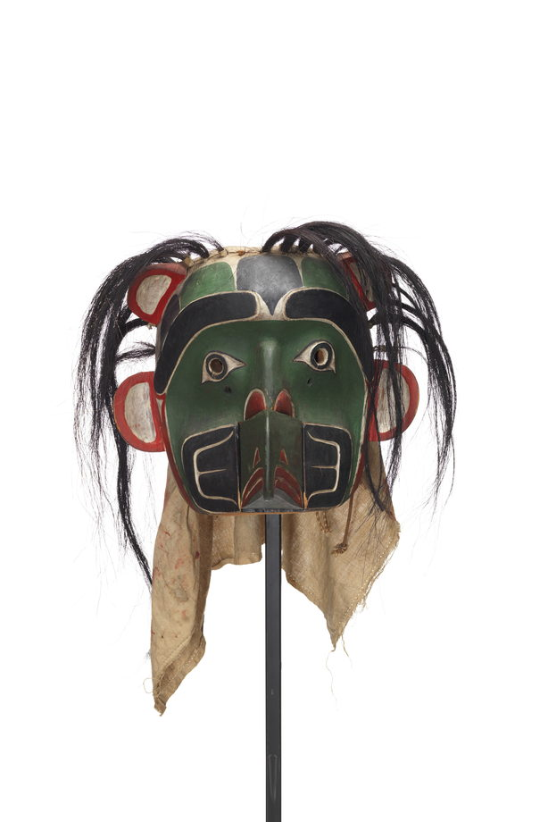 Sapagamł or echo mask, green and black with white red trim, interchangeable mouthpiece shown with bear