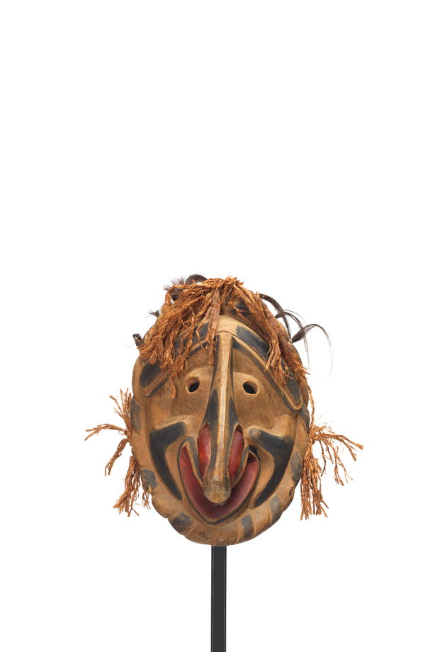 a Nułamał or fool dancer, clown like expression, enormous downturned nose, red nostrils and lips, black markings with cedar and hair trim