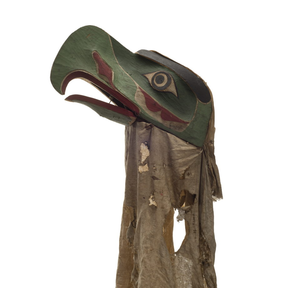 Kulus or down-covered bird, carved from cedar, broad curved beak, hinged lower jaw, mottled cloth head cover with nail fragments and rust blotches