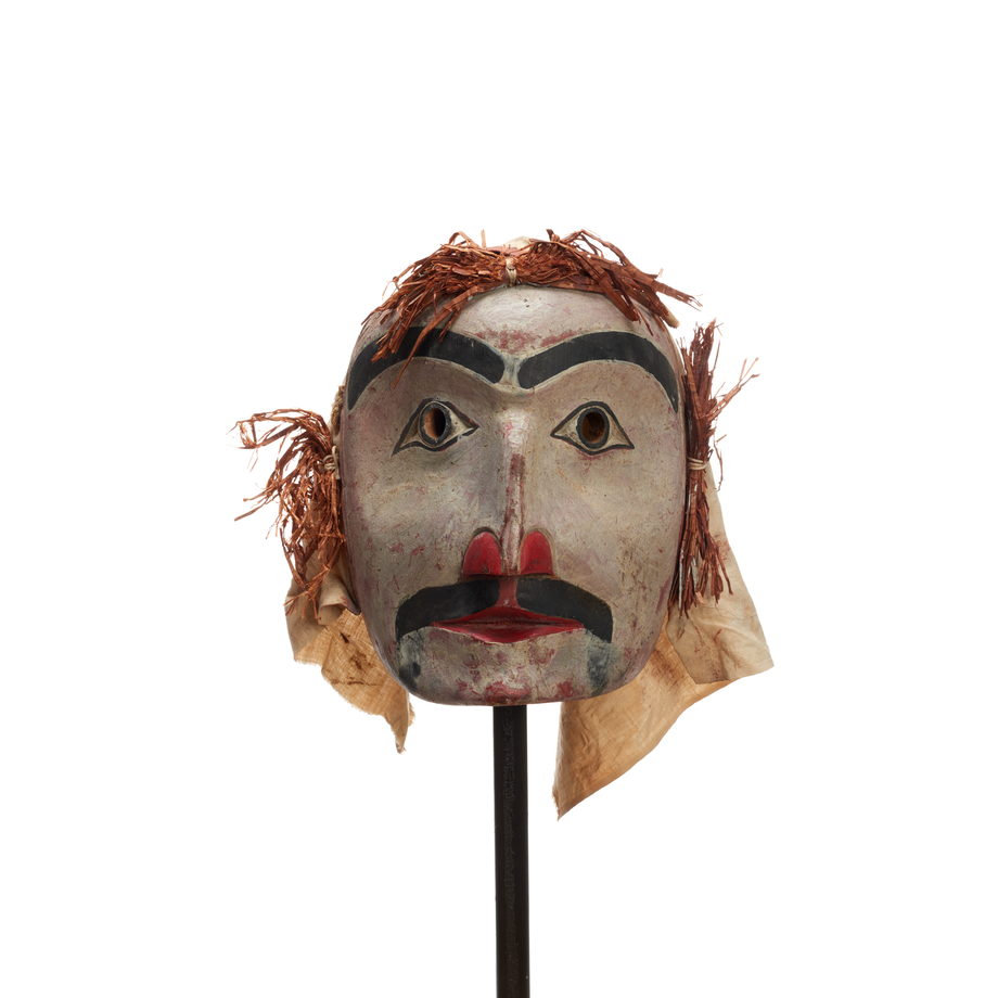 Atłakima or Forest Spirits Mask, white- washed cedar, rounded face shape with cedar bark hair and cotton back, dark prominent moustache and eyebrows