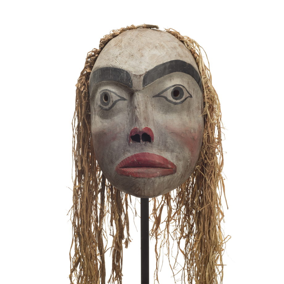 Forest spirit mask, feminine appearance, red lips and trim surrounding nostrils, rosy cheeks and long cedar bark trim