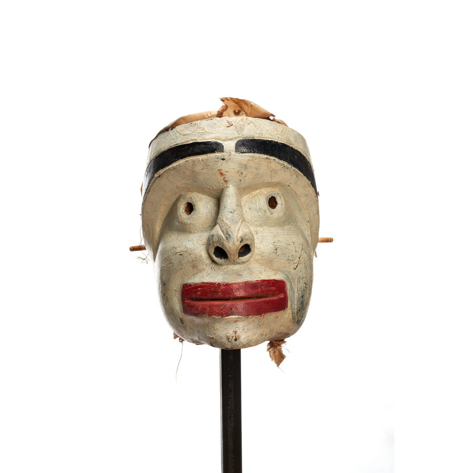 Atłakima or Forest Spirits Mask, white- washed cedar, square face shape with wide thick bright red lips, dark eyebrows with some cedar trim for hair