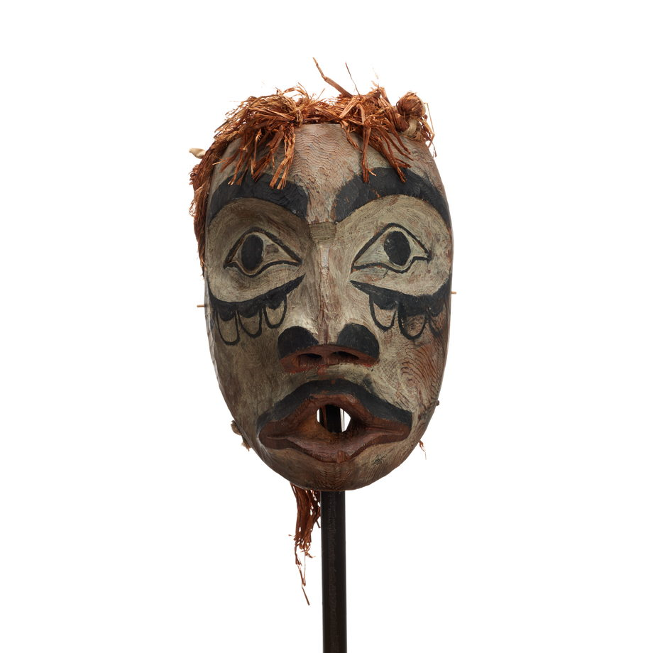 Wawaxanuwilana (Ground Preparer) mask, a type of ATŁAKIMA FOREST SPIRITS MASK white washed with black markings on cheeks, pursed red lips with moustache
