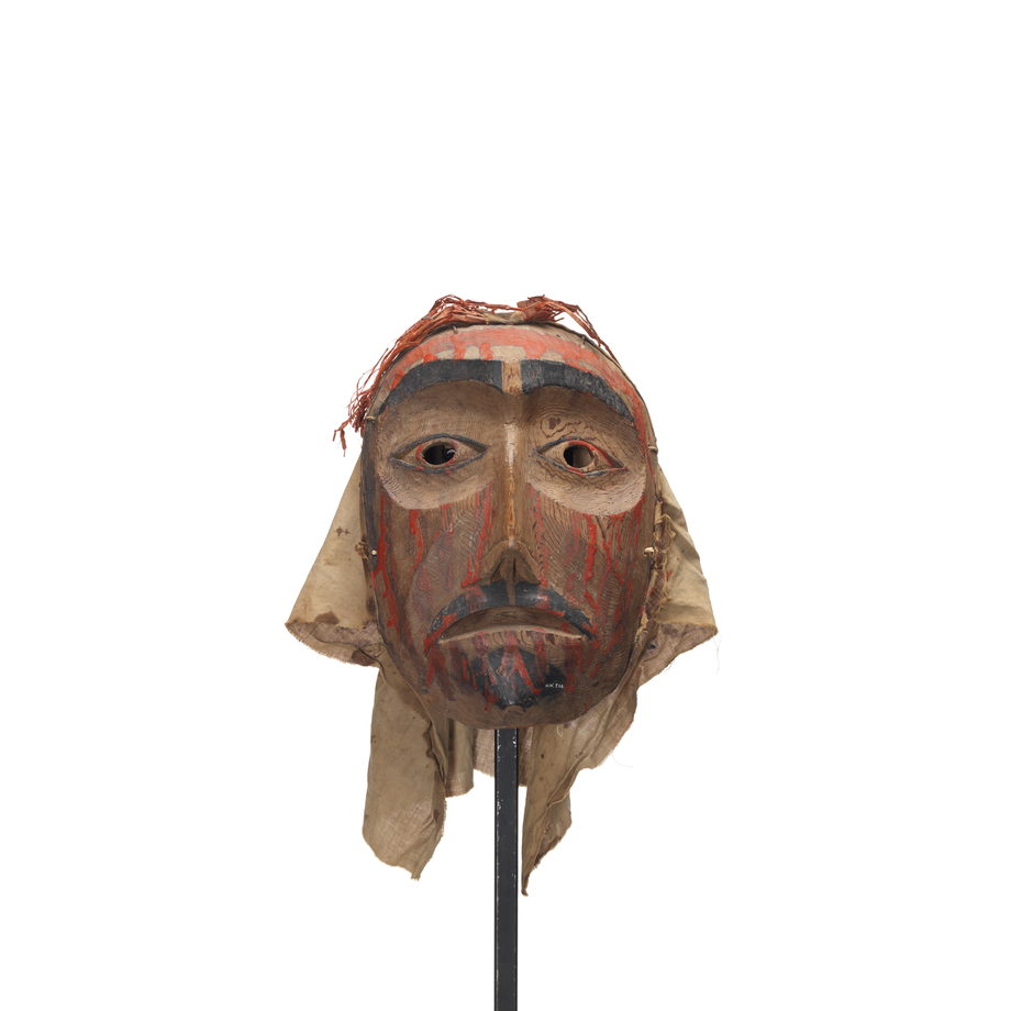 Mourning mask with red paint drips representing blood on forehead, cheeks and chin. Black painted goatee, lips and eyebrows.