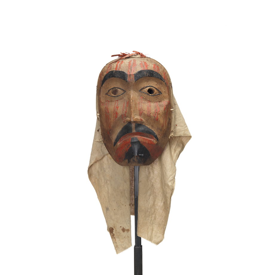 Cedar mourning mask. Eyebrows, eyelids, moustache and goatee black. Red lips and vertical double lines on face. Cotton back.