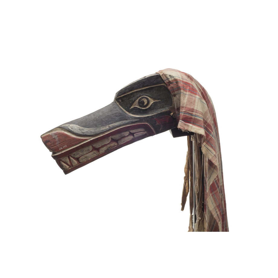 Xisiwe' or wolf mask, one of several with long snout and large teeth, painted red and black with plaid cotton head cover