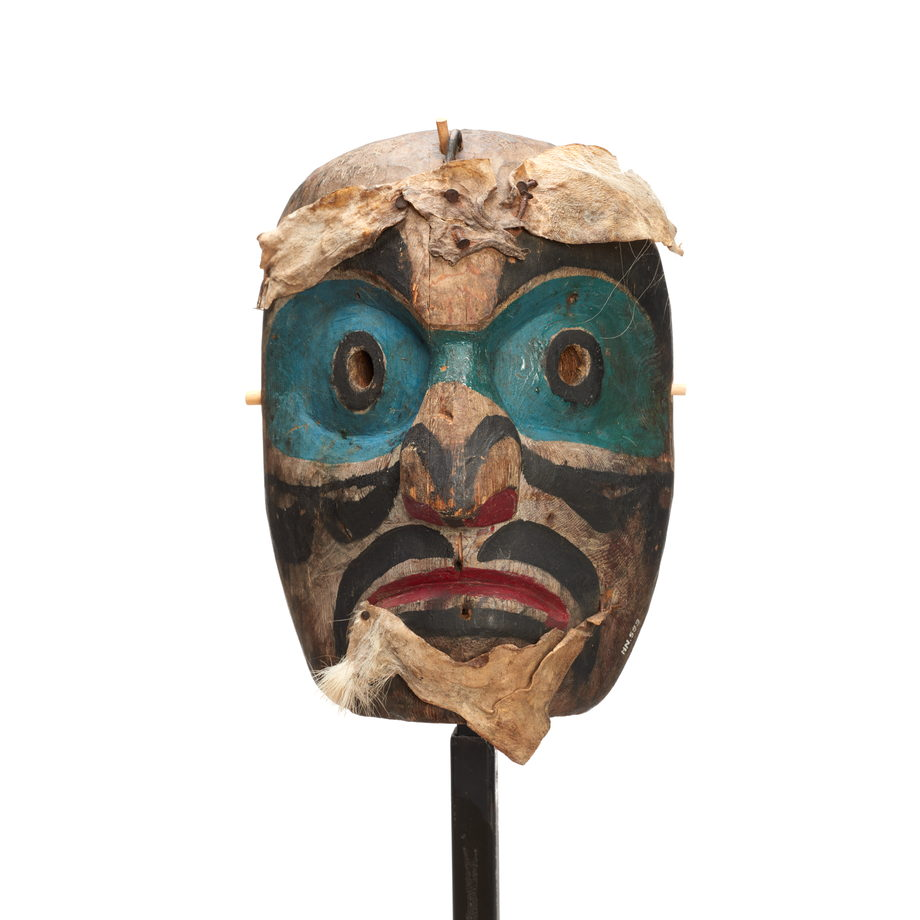 Speaker mask. Bright blue paint around eyes and bridge of nose, black paint markings on forehead, cheeks, nose and lips. Fur attached to brow and chin.