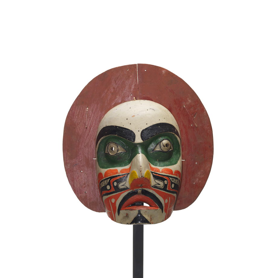'Makwala or moon mask, red painted circular shape surrounds face which is painted white with green patches around eyes, black, orange yellow patterns