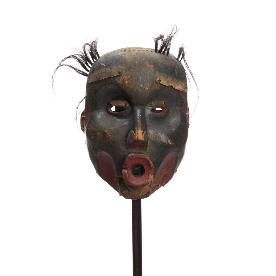 Dzunukwa or Wild Woman of the Woods, deeply carved, near black finish, large pursed lips and tufts of hair