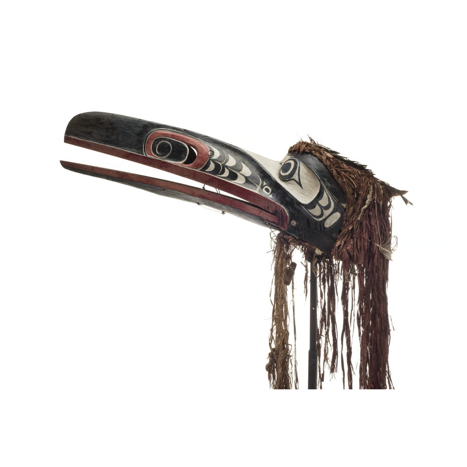 Raven mask with long hinged beak, mostly black with red trim, carved nostrils white areas around eyes and beside nostrils, cedar trim on top and below.