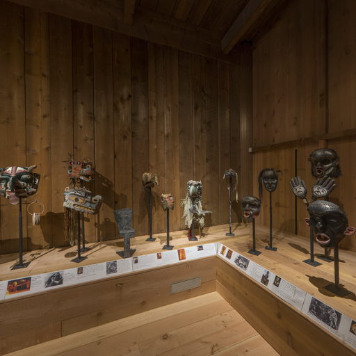 Image of the south-west corner of the Potlatch Gallery showing a group of masks.