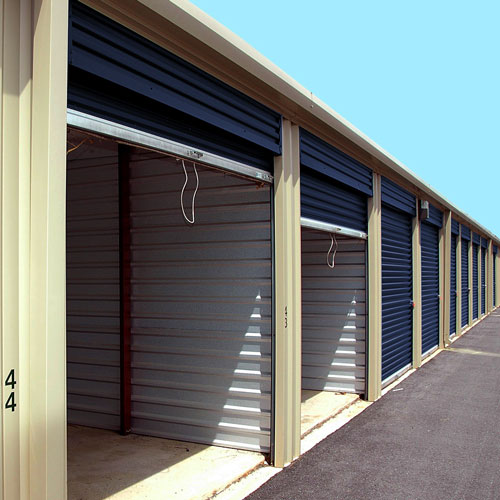 Photograph of outdoor self storage units with blue doors.
