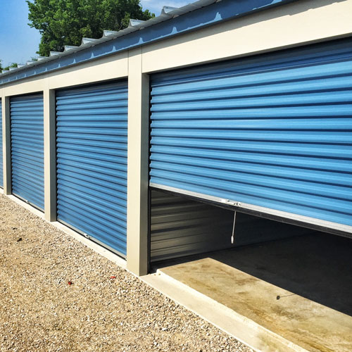 Photo of self storage units with blue roll up doors