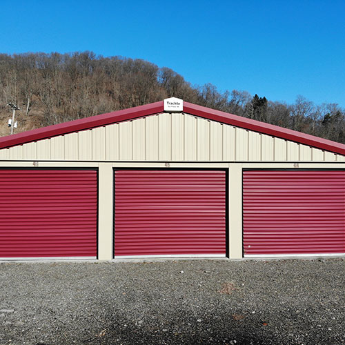 Outdoor storage units with roll up doors at Zeke's Self Storage