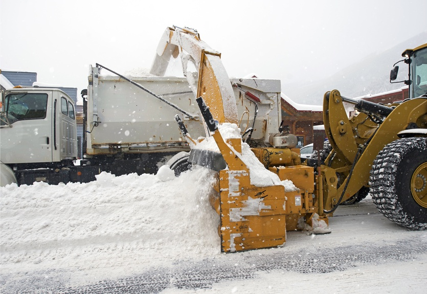 Snow pusher for skid steer