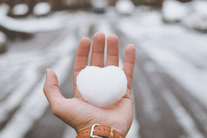 person holding white snow