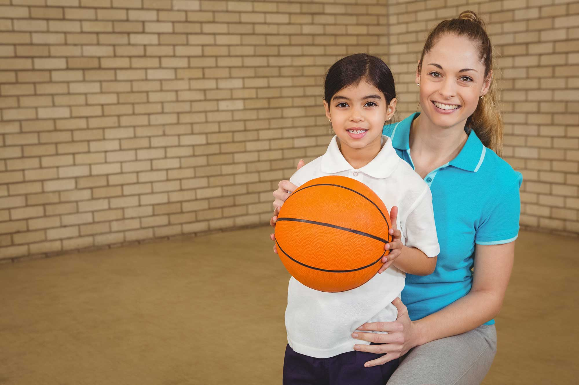 physical education teacher with child